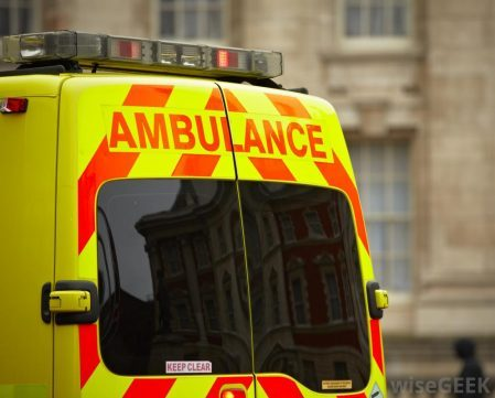 yellow-and-red-ambulance-near-building